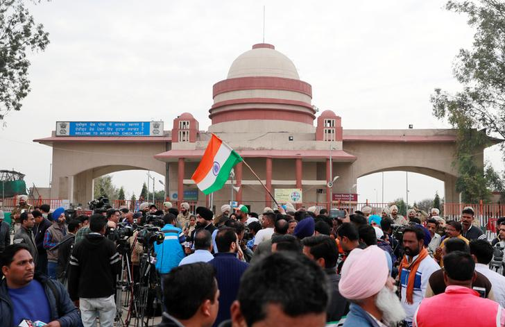 People and media gather before the arrival of Indian Air Force pilot, who was captured by Pakistan on Wednesday, near Wagah border, on the outskirts of the northern city of Amritsar
