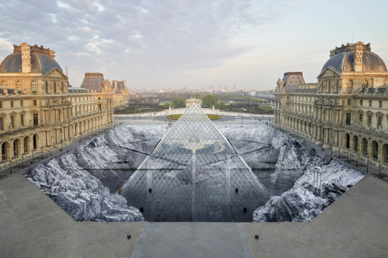 Success shreds JR's Louvre illusion