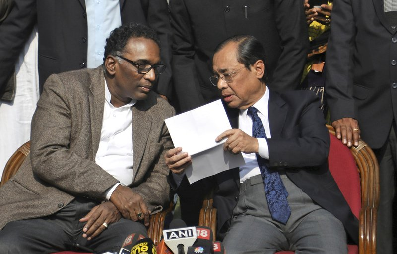 Indian Supreme Court judge Justice Ranjan Gogoi, right, speaks with Justice Jasti Chelameswar-AP