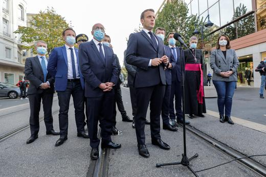French-President-Emmanuel-Macron-speaks-to-the-media-during-the-visit-to-the-scene-of-a-knife-attack-REUTERS