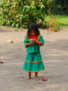 A little girl in the dress of the Siona tribe