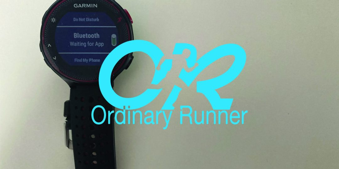 Garmin watch waiting to connect to app with the Ordinary Runner logo overlaid