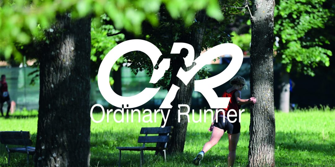 Woman stretching by a tree, overlaid by the Ordinary Runner logo