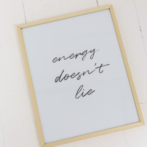 Energy doesn't lie black text print in gold frame