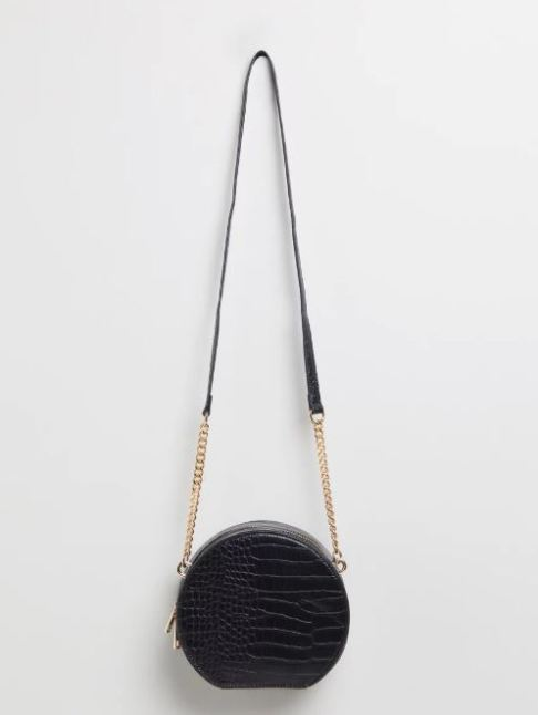 Black round shoulder bag with a black and gold chain