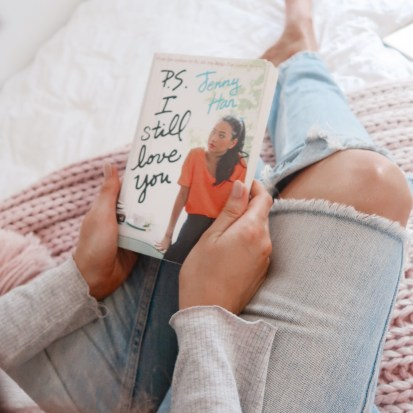 girl holding P.S I still love you by Jenny Han