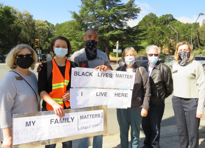 (Kathy Enzerink, Photographer)Mayor Darlene Gee, Tatiana and Neil Pretlow who organized the peaceful protest, Councilmembers Amy Worth, Dennis Fay and Inga Miller
