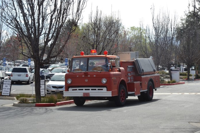 (Courtesy of Sally Hogarty)The 1971 Ford Fire Truck, owned by Fourth Bore Tap Room and Grill's Michael Karp, turns into John Muir Medical Center in Concord to deliver 250 meals and gratitude cards to frontline workers.