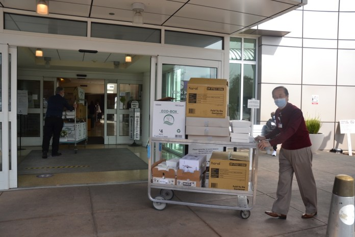 (Courtesy of Sally Hogarty)Buddy Santoso: John Muir Medical Center Concord's Buddy Santoso wheels in approximately 100 of the 250 meals delivered on March 16.