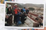 Free Tibet page woman shielding her face