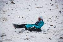 Iran, North Khorasan province, Mahnan village near Bojnourd Families Sliding on Snow 01