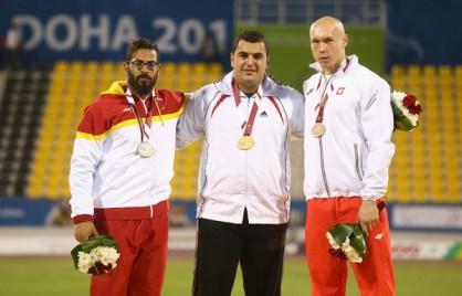 2015 IPC Athletics World Championships - F12 Men's Discus Throw - Medalists Saman Pakbaz, Iran (Gold), Kim Lopez Gonzalez, Spain (Silver), Marek Wietecki, Poland (Bronze)