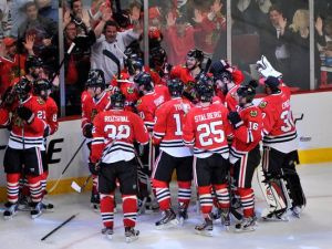 Blackhawks mob Brent Seabrook after he scores the winning goal