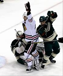 The Blackhawks' Patrick Sharp (middle) celebrates his first-period goal