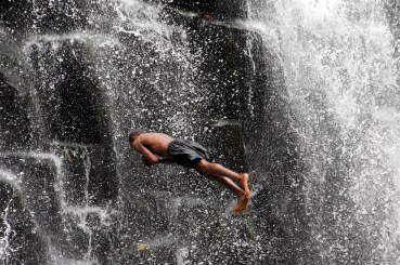 Brave or crazy? Backflips from the top of the falls
