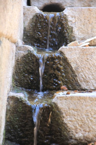 Water from the sacred spring trickles down the stairs into the tunnel. The sound of the water was meant to bring a feeling of harmony to the sufferer