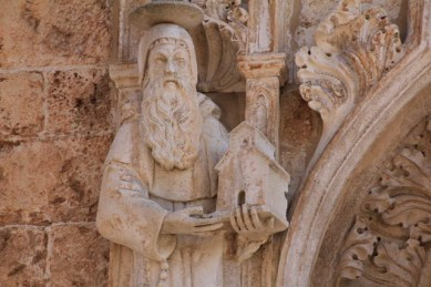 St Blaise, the patron saint of Dubrovnik. Statues and relief's of him everywhere. He is always depicted holding the town in his hand.