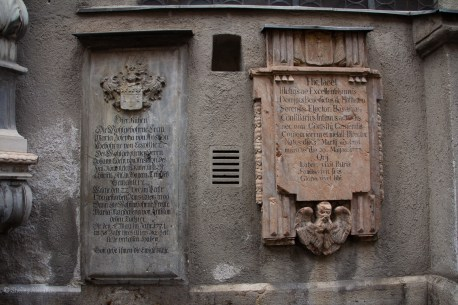 In the walls are many gravestones and plaques