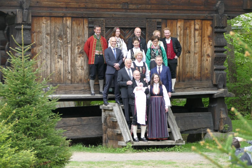 Norwegian family posing for photos after (apparently) a baptism. Love the traditional dress.