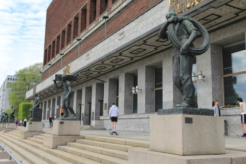 Statues of workers line the front of the City Hall