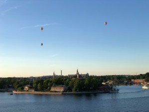 (8:35pm) Watching balloons rising over Stockholm from the deck of the Viking Sea