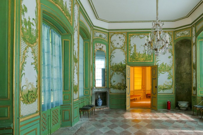 The green drawing room. The walls are painted with 18th C European paintings depicting their somewhat romantic notion of life in China.