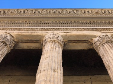 The pediment was restored in modern times, and there are questions about its authenticity.