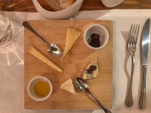 Selection of fine Italian cheeses served with honey and preserves