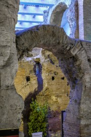 Part of a series of arches and passageways under the seating area