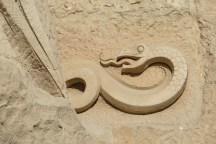 The snake, representing Satan, peeks oout behind the kiss of Judas