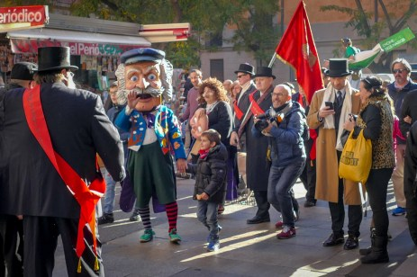 In this Catalan tradition, a jumping jack with as many noses as days left in the year (a large nose) walks through the city's streets giving out sweets to the kids. On 31 Dec he has only one nose left, hence the parade, apparently.