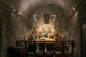 In a little side chapel, a life-sized representation of the Holy Sepulchre