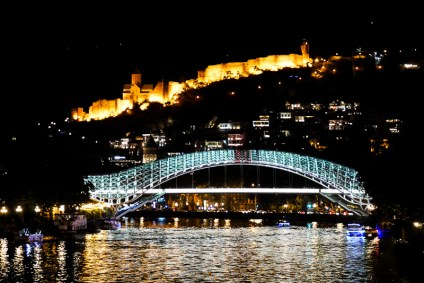 The Bridge of Peace & Narikala Fortress lighting up the night.