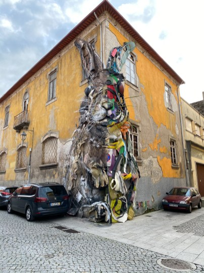 "Amazing street art called ""Half Rabbit"" by Bordalo II, created using found materials and trash gathered around the city. Half of the piece is left unpainted and shows the elements' original colors."
