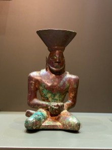 Copper alloy censer in the form of a seated man with a basket on his head. Mesopotamia, ca 2650 to 2550 BCE