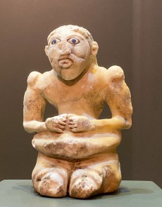 Limestone or Calcite Kneeling Man with inlaid eyes of shell and lapis lazuli. Southeastern Iran, Mid 3rd millennium BCE