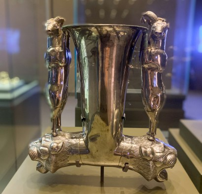 Silver drinking vessel with handles in the form of wild sheep standing on lions' heads. Western Iran, late 7th to early 6th century BCE