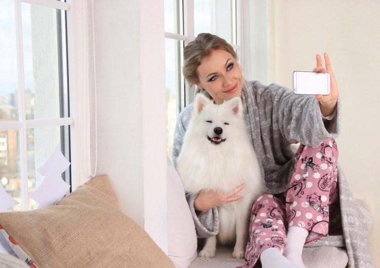 Woman taking pet photo selfie