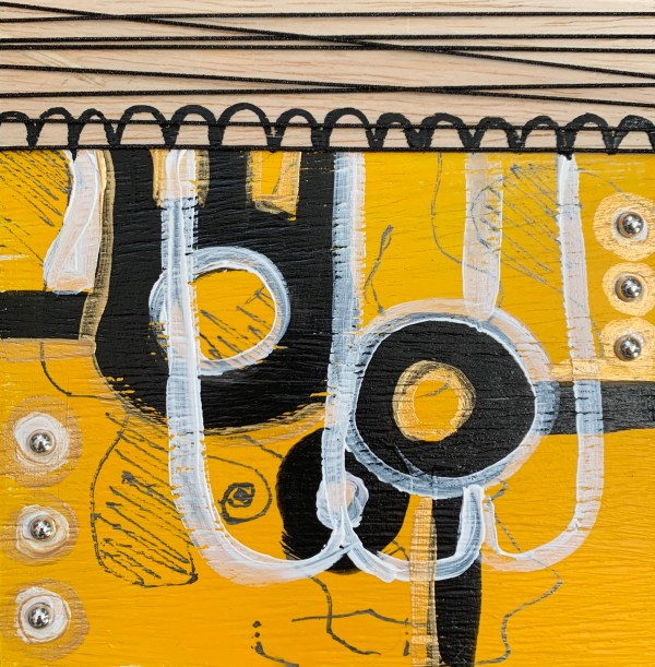 yellow and black abstract painted wood block