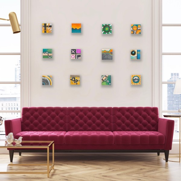Wood block wall art collage above magenta couch