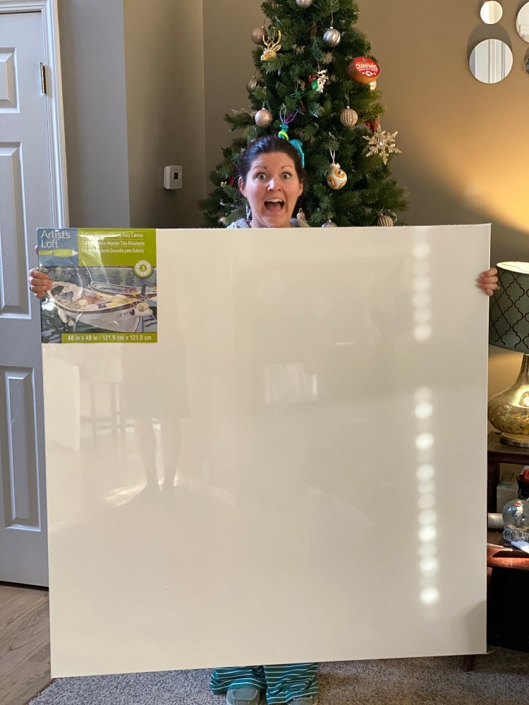 "Me holding a giant 48"" square heavy duty canvas for painting with acrylics"