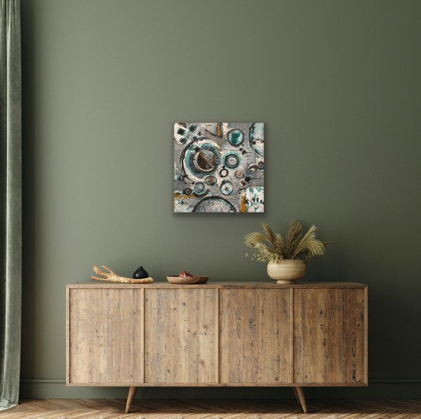 Abstract mixed media painting above cabinet
