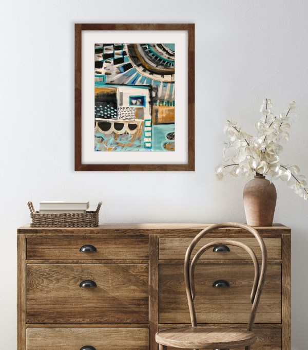 abstract painting framed above dresser