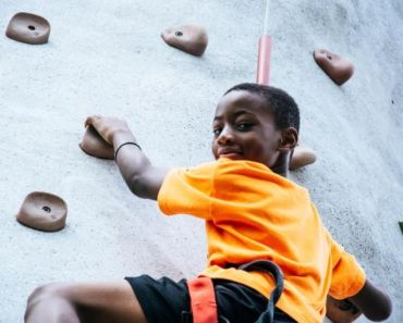 Young boy rock climbing