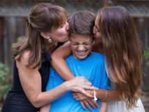Tina Foote with children Rachel and Connor Foote. Even without a father, a strong and loving family dynamic is possible.