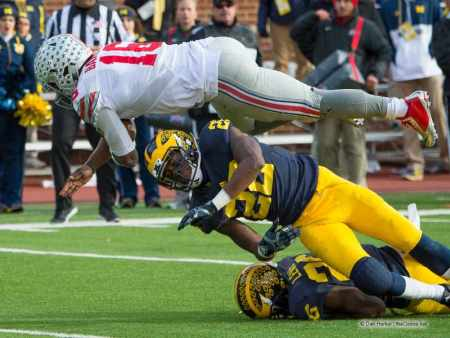 Ohio State Buckeyes quarterback J.T. Barrett dives into the end zone against the Michigan Wolverines.