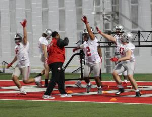 "Larry Johnson leads Tommy Togiai and Nick Bosa in a ""match the hand"" drill."