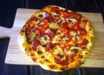 Russell's Little Secret. Stone Pizza. With Ham, Sopressa, Capsicum, Confit Garlic, Basil and Mozzarella