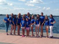 The contestants, Olivia, Joelle, and the TI Princesses by the river before the show