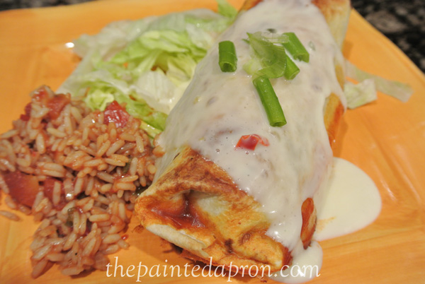 queso topped beef and veggie burritos thepaintedapron.com